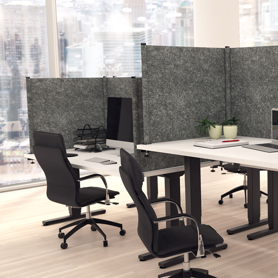 privacy screens around a group of desks in an office
